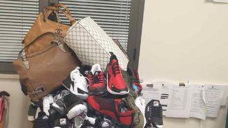 foto di borse e scarpe risultato del sequestro vestiti griffati falsi a capo d'orlando in provincia di messina