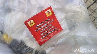 bollino rosso di messinaservizi su un rifiuto conferito in maniera scorretta in occasione del servizio di raccolta differenziata porta a porta a messina