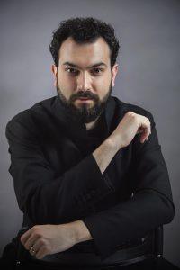 Foto del direttore d'orchestra Marco Alibrando